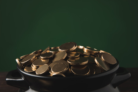 close up of golden coins in pot, st patricks day concept