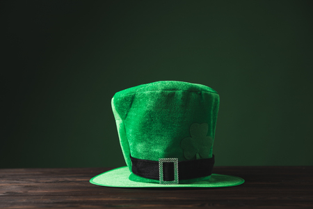 green hat on wooden table, st patricks day concept Stok Fotoğraf