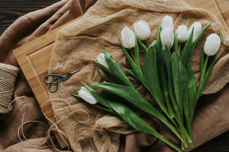 top view of white spring tulips on wooden board for international womens day Zdjęcie Seryjne