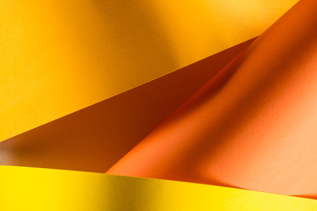 close-up shot of orange and yellow colored papers for background Banco de Imagens - 95330831