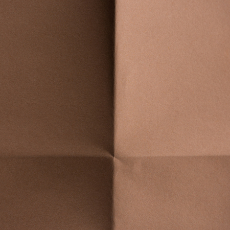 close-up shot of brown colored folded paper for background