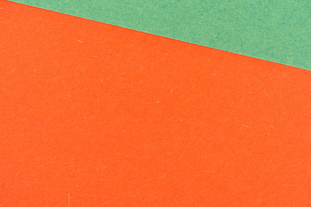 close-up shot of orange and green paper layers for background 版權商用圖片