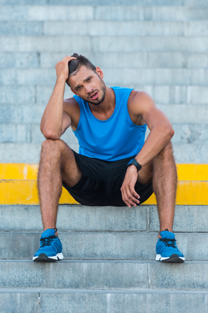 tired sportsman on stairs