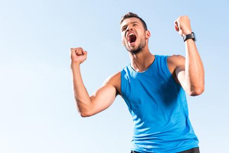 deportista celebrando el triunfo Foto de archivo
