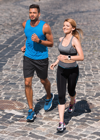 sport couple jogging in city Stock Photo