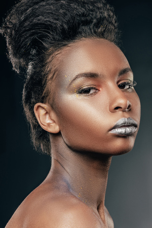 stylish afro girl with silver makeup