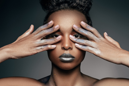 african american girl with silver makeup