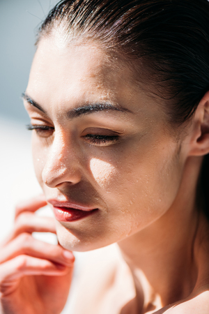 woman with droplets on face