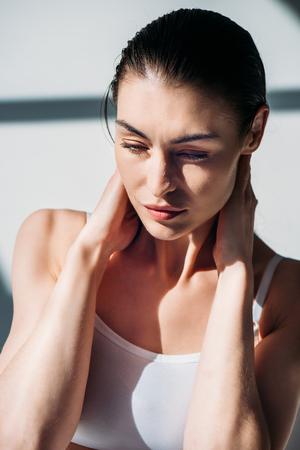 woman slicking back wet hair