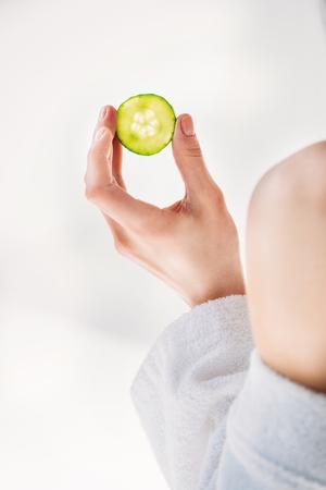 woman holding cucumber Stock Photo