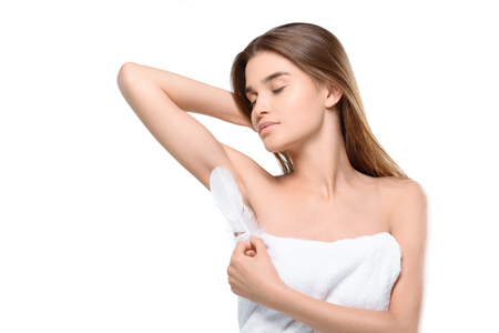 woman touching armpit with feather Stockfoto