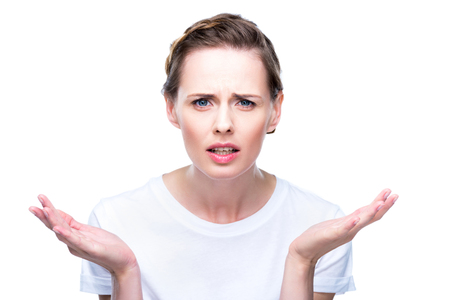 confused woman with shrug gesture Stock Photo