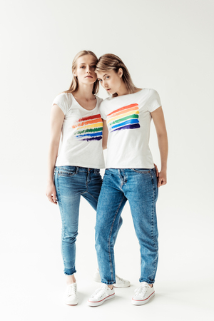 Women in white shirts with printed rainbow Stock Photo