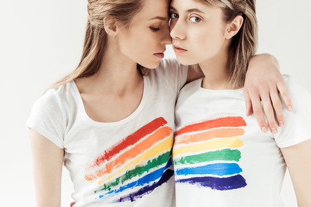 lesbians in white shirts with printed rainbow