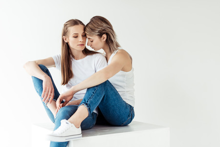 lesbian couple hugging each other Stock Photo