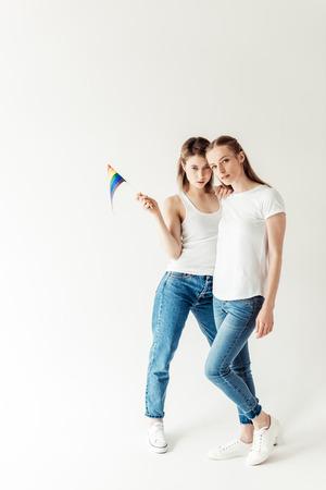 Lesbian couple with small rainbow flag