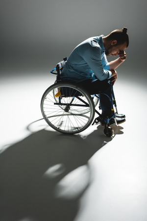 Despaired man in wheelchair 스톡 콘텐츠