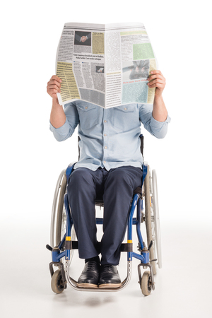 man in wheelchair with newspaper