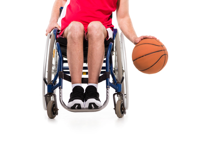 sportsman in wheelchair playing basketball 写真素材