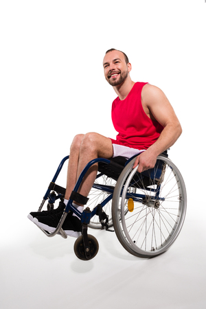Smiling sportsman in wheelchair Stock Photo