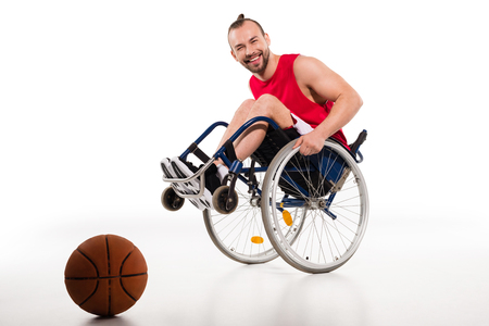 Smiling basketball player in wheelchair Stock Photo