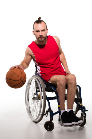 Disabled sportsman playing basketball 스톡 콘텐츠