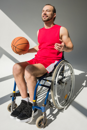 Handicapped sportsman holding basketball