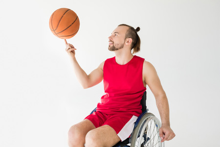 sportsman in wheelchair playing basketball Stock Photo