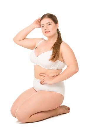 overweight woman posing in white underwear Standard-Bild