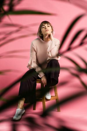Woman posing on stool 版權商用圖片