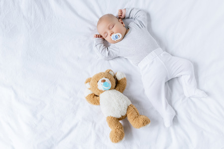 sleeping baby with toy Stockfoto