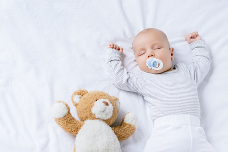 sleeping baby with toy 스톡 콘텐츠