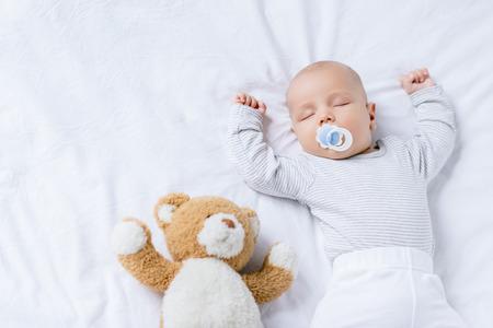 sleeping baby with toy Archivio Fotografico
