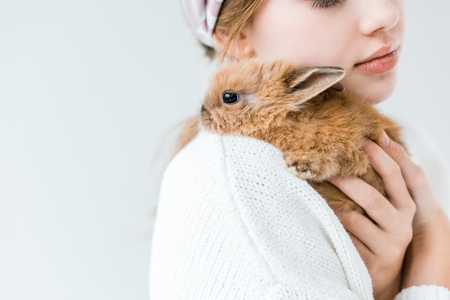 child holding cute furry rabbit isolated on white Zdjęcie Seryjne - 96784372