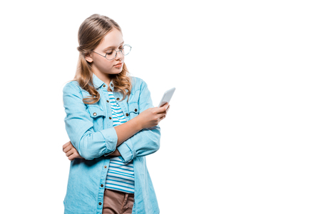 girl in eyeglasses using smartphone isolated on white