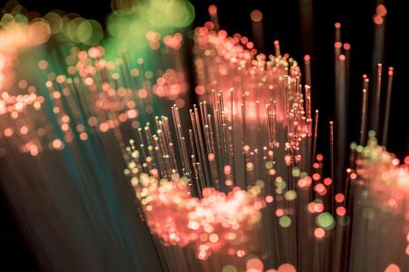 Close up of shiny pink fiber optics texture background Stockfoto