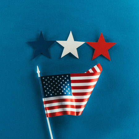close up view of stars and american flag isolated on blue