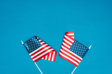top view of american flags isolated on blue