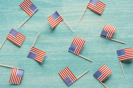 top view of arranged american flags on blue wooden surface
