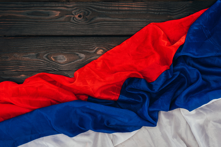 close up view of russian flag on dark wooden surface