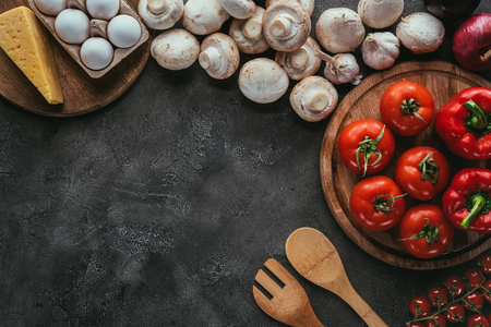 top view of different raw ingredients for pizza on concrete table