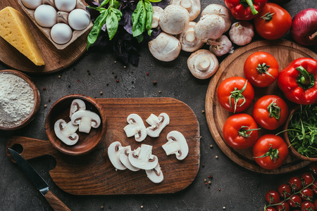 top view of various raw ingredients for pizza on concrete surface Stock Photo