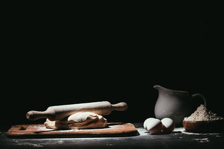 dough with ingredients and rolling pin on black Stock Photo - 97253641