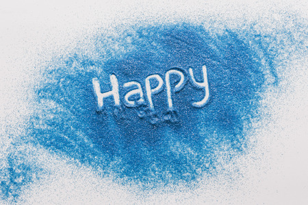 top view of happy sign made of blue sand Stock Photo