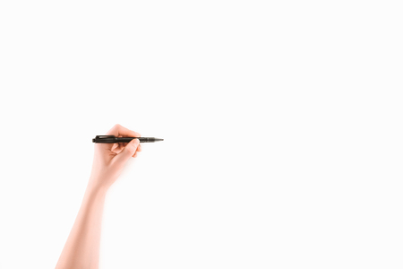 cropped image of lefthanded woman writing something with marker isolated on white