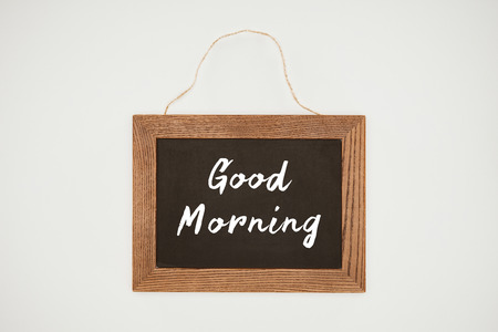 good morning lettering on chalkboard with wooden frame and thread isolated on white Zdjęcie Seryjne