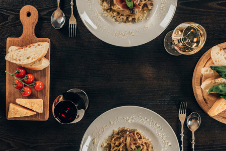 plates with different pasta on table at restaurant