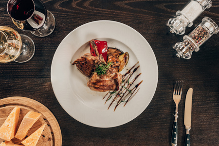 top view of grilled chicken with vegetables on plate on table