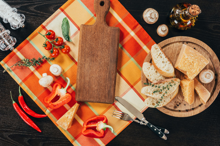 top view of cutting boards with vegetables and parmesan cheese on table Standard-Bild