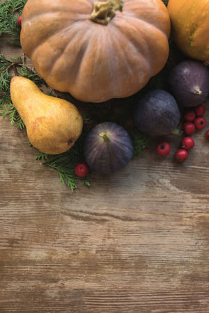 Top view of composition with pumpkins, figs, pears and rosehip on wooden table Stock Photo